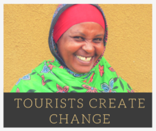 Tourists create change - woman wearing a brightly coloured scarf and smiling