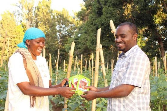 Johari Ramadhani receiving the first seeds for her plot