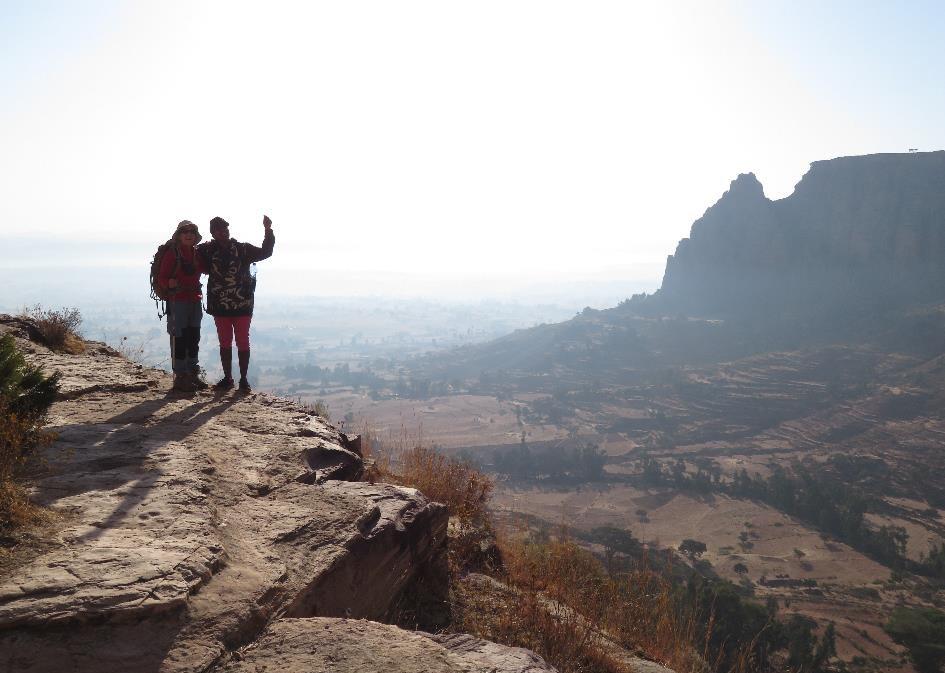 Berhan on a hike with a tourist